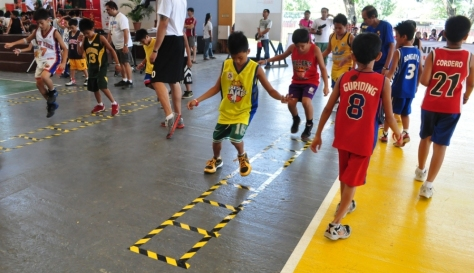 Young players hone their basketball skills through drills and activities during the Jr. NBA School Clinic hosted by Phoenix Petroleum at the Ateneo De Davao University sports complex on February 3, 2013.