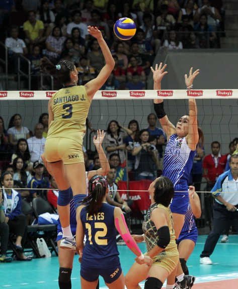 Towering 6-4 Jaja Santiago goes for a spike against Ateneo's Jeng Bualee during Game Two of their title series in the Shakey's V-League Season 10 First Conference at the MOA Arena.