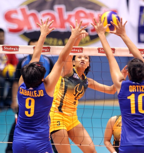 Air Force's Maika Ortiz (right) foils FEU's Marie Simborio's attack as Jude Ann Caballejo tries to provide help during their Shakey's V-League Open Conference clash.