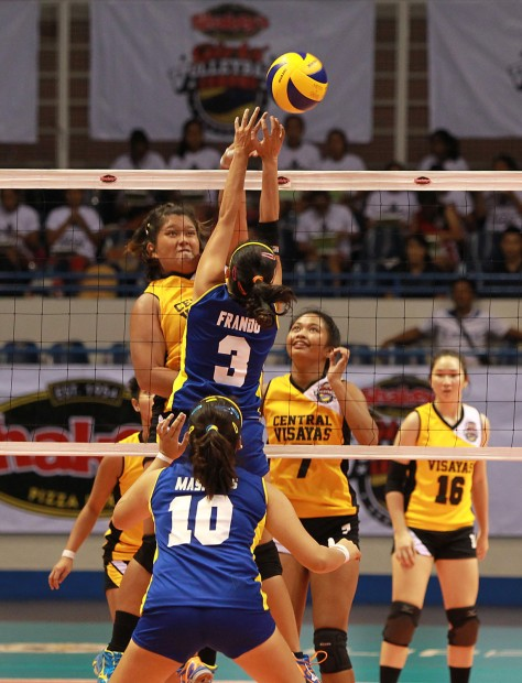 Central Visayas' Mary Pacres of University of San Jose-Recoletos scores against the outstretched arms of Mindanao's Nicole Frando of Ateneo de Davao during their Shakey's Girls Volley T-of-C clash at the Ninoy Aquino Stadium.