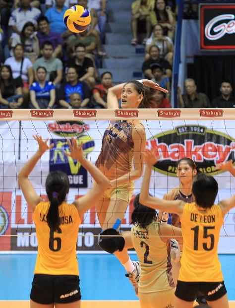 National U's Jaja Santiago takes off for a spike against UST's Pam Lastimosa and Jessey de Leon during their Shakey's V-League Season II First Conference duel at The Arena.(pr photo)