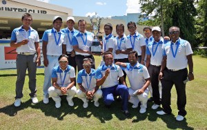 Skipper Jerome Delariarte (standing, fourth from left) and assistant team captain Rufino Bayron hold the huge trophy as members of Team South celebrate their runaway victory over North squad in The Duel 3 at the Cebu Country Club yesterday. The other members of the team are (front row, from left) Charles Hong, Jhonnel Ababa, Marvin Dumandan and Cassius Casas, (standing, from left) Clyde Mondilla, Jessie Balasabas, Elmer Saban, Mhark Fernando, Frankie Minoza, Jay Bayron, Elmer Salvador and Tony Lascuna.(pr photo)