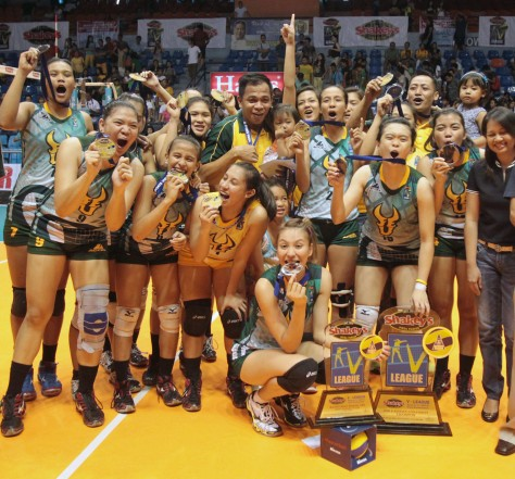 The FEU Lady Tams, led by coach Shaq delos Santos and Finals MVP Rachel Ann Daquis, celebrate their victory in the Shakey's V-League Season 11 First Conference, the school's first championship since the league inaugurals in 2004.(pr photo)