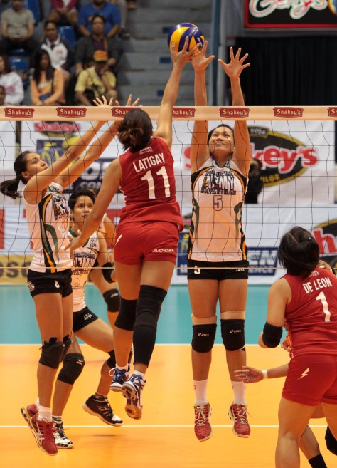 PLDT Home Telpad's Laurence Ann Latigay (11) unleashes a power tip against Army's MJ Balse as Lady Trooper Jovelyn Gonzaga (left) tries to provide help.(pr photo)