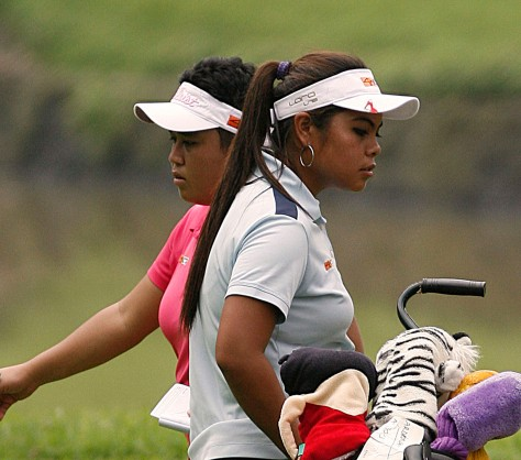 Dottie Ardina (right) and Lovelynn Guioguio go separate ways after reaching the green on No. 2.(pr photo)