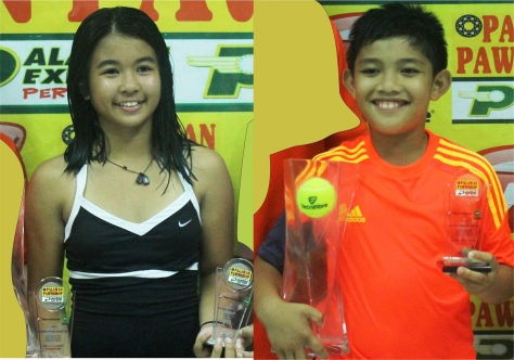 Gaby Zoleta (left) and Magnus Gnilo display their twin trophies after ruling their respective divisions in the Lucena leg of the Palawan Pawnshop regional age group tennis in Lucena.(pr photo)