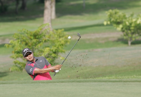 Charles Hong blasts out off the bunker on No. 1.(pr)
