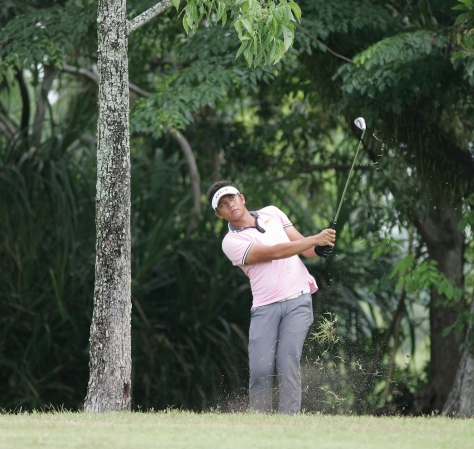 Clyde Mondilla hits an approach shot from under the trees on No. 10.(pr)