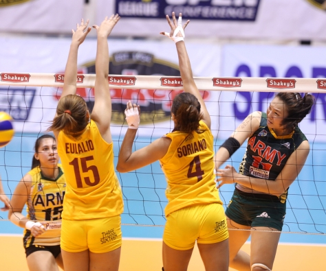 Army's Honey Royse Tubino (right) bangs away a spike against Cagayan Valley's Wenneth Eulalio and Pau Soriano during their faceoff for the second finals berth in the Shakey's V-League Season 12 Open Conference at The Arena in San Juan.(pr photo)