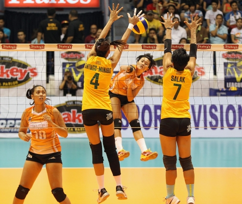 Dindin Santiago-Manabat and Tina Salak underscore Army's tough net defense as they foil PLDT's Gretchel Soltones' attack in the opener of the Shakey's V-League Season 12 Open Conference finals at The Arena in San Juan yesterday.(pr photo)